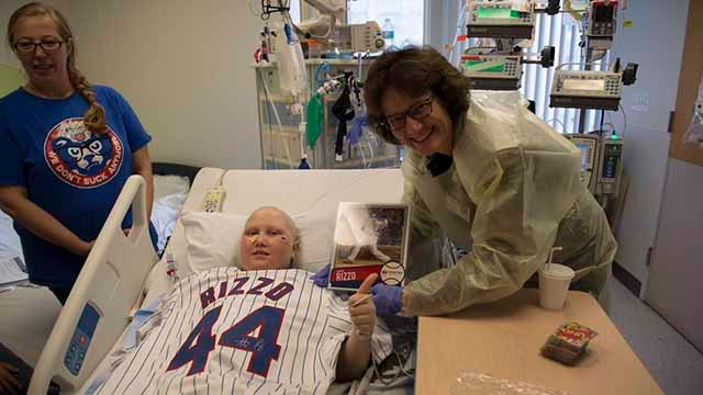 A new Anthony Rizzo signed photo and jersey were presented to Abby Schrage, 12, after the original signed photo disappeared. Credit: St. Louis Children's Hospital