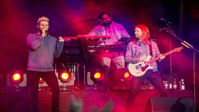 Adam Levine, from left, PJ Morton and James Valentine of Maroon 5 perform at BottleRock Napa Valley Music Festival at Napa Valley Expo on Friday, May 26, 2017, in Napa, Calif. (Photo by Amy Harris/Invision/AP)