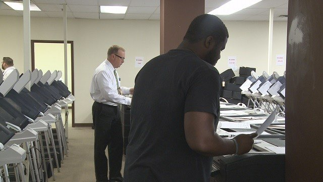 (Credit: St. Louis City workers are testing all voting equipment that will be used in less than two weeks.