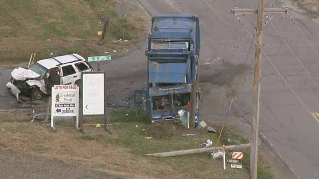 Three people were hospitalized in after an accident involving a trash truck and SUV in Fairview Heights Friday. Credit: KMOV