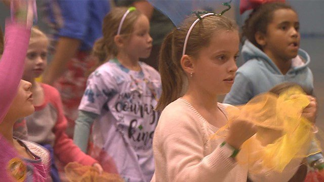 """Thousands of scouts and their families spend the day at America's Center in downtown St. Louis for """"Shades of Green."""" (Credit: KMOV)"""