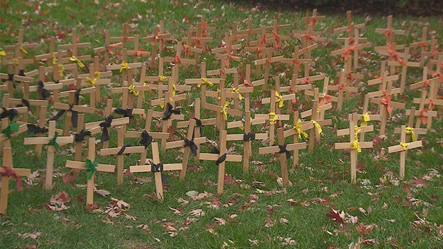 Fifty wooden crosses put up by pro-life group have vanished once again from St. Louis University's campus. (Credit: KMOV)