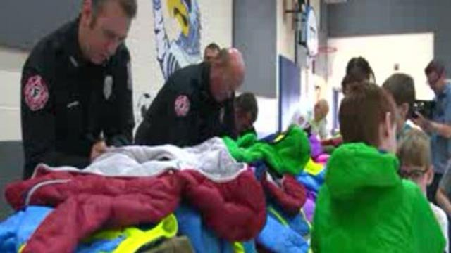 Cottleville firefighters giving coats to students (Credit: KMOV)