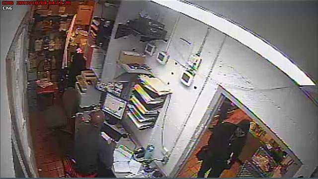 Robbery suspect entering the manager's officer at the Overland Steak 'N Shake (Credit: Overland Police)