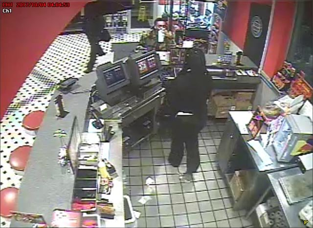 Person of interest sitting at the counter of an Overland Steak 'N Shake (Credit: Overland Police)