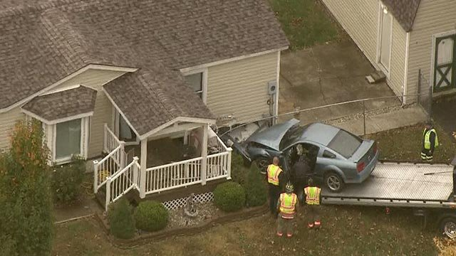 A car crashed into a home on Powell in O'Fallon, Illinois Tuesday (Credit: KMOV)