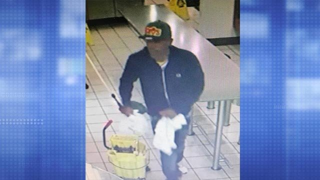 Police in Webster Groves are asking for help identifying this armed robbery suspect (Credit: Police)