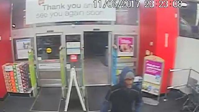 Surveillance photo of Walgreen's robbery suspect (Credit: St. Louis Police)