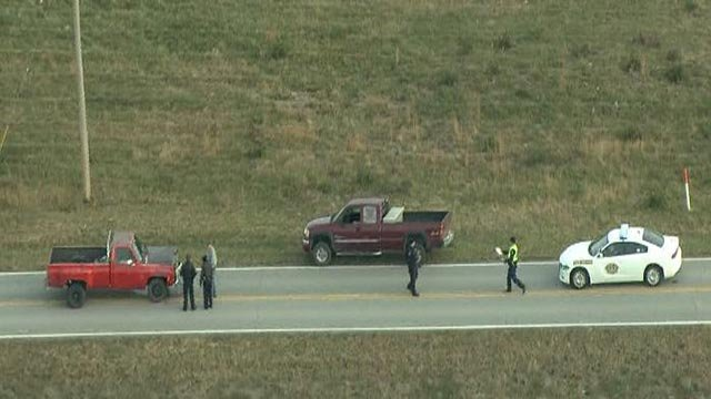 The scene on North Service Road after a person was struck and killed Friday (Credit: KMOV)