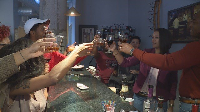 Master Sergeant Danielle Harris toasts with her family. (Credit: KMOV)