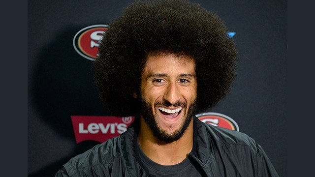 Colin Kaepernick talks to the media at a news conference an NFL preseason football game (AP Photo/Denis Poroy)