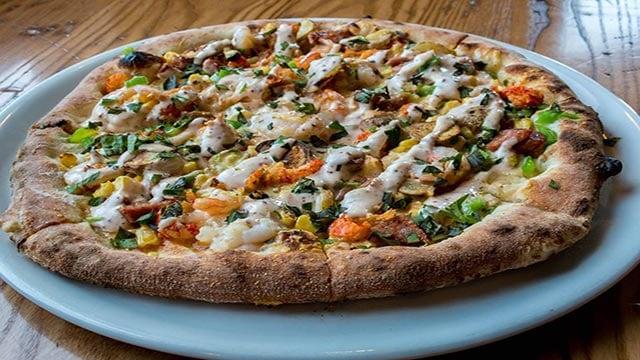Peel Wood Fired Pizza's Breaux Bridge special pizza (Credit: Peel Wood Fired Pizza / Facebook)