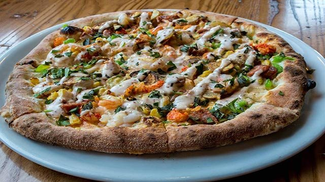 Peel Wood Fired Pizza's Breaux Bridge special pizza (Credit: Peel Wood Fired Pizza / Facebook)
