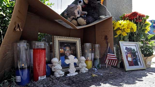 A makeshift memorial for shooting victim Anthony Naiboa sits on a sidewalk in the Seminole Heights section of Tampa, Fla., Tuesday, Oct. 24, 2017. AP Photo/Chris O'Meara)