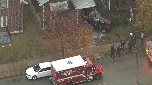 A vehicle crashed into a home in north St. Louis Wednesday morning (Credit: KMOV)