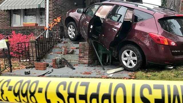 A SUV crashed into a home at Marcus and Lee in north St. Louis (Credit: Justin Andrews / News 4)