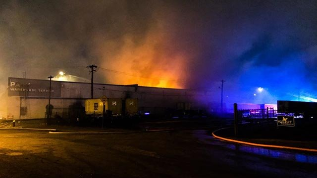 The Park Warehouse Service building continued to burn Thursday morning (Credit: St. Louis Fire Department)