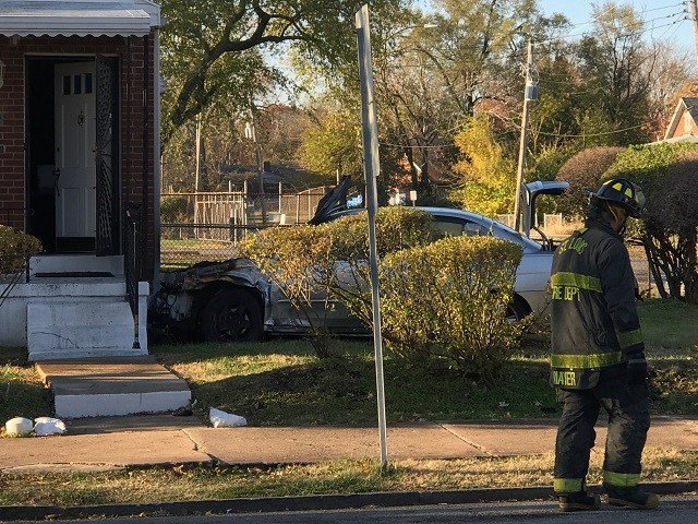 Car crashed into home in North St. Louis (Credit: KMOV)