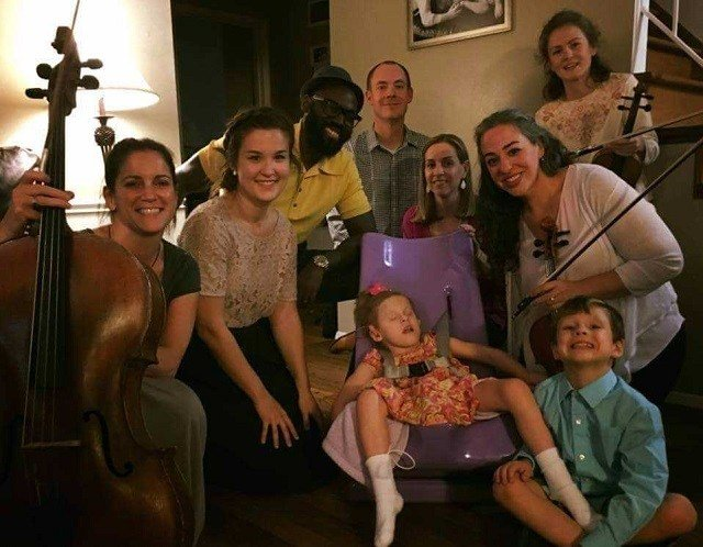 St. Louis Symphony Orchestra members with Faith and her family. (Credit: St. Louis Symphony Orchestra)