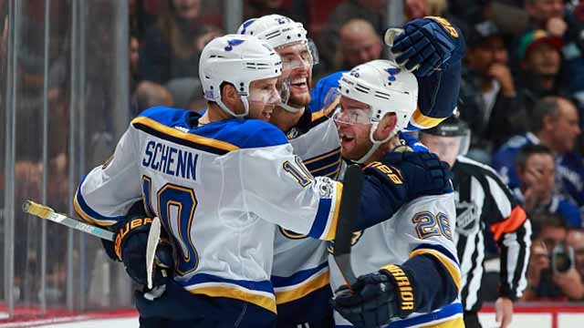 Brayden Schenn #10 of the St. Louis Blues is congratulated by teammates after scoring an overtime goal during their NHL game against the Vancouver Canucks at Rogers Arena November 18, 2017 in Vancouver, British Columbia. St. Louis won 4-3. (Getty images)