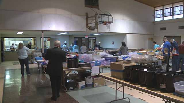 Volunteers pack gift boxes as part of Operation Christmas Child. Credit: KMOV