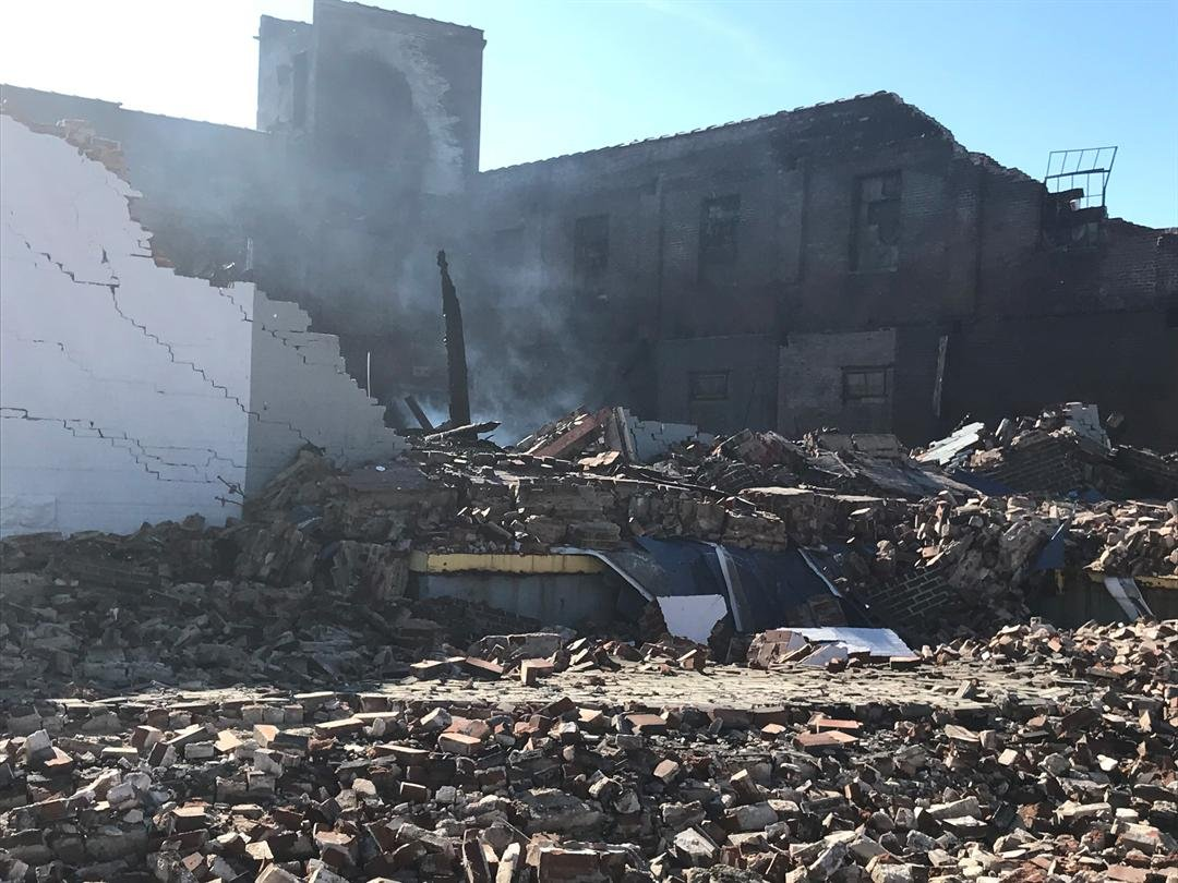 Exterior view of the north side of the Parks Warehouse Services building where there was a partial wall collapse during a huge fire.