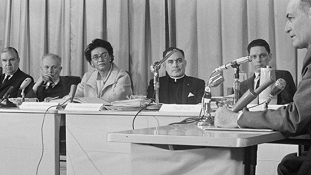 Mississippi Gov. Paul Johnson, right, reads a statement before the U. S. Commission on Civil Rights which opened a public hearing in Jackson, February 16, 1965.