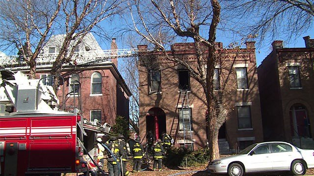 Firefighters rescue man in South St. Louis fire. (Credit: KMOV)