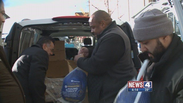 The R. Whittington Foundation handed out 750 turkeys to St. Louis police and firefighters. (Credit: KMOV)