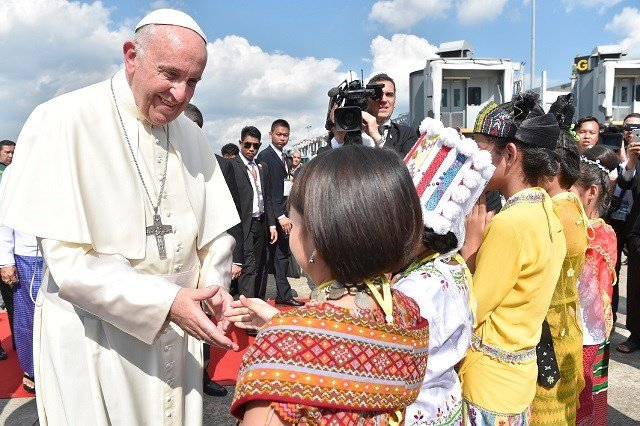 Pope Francis greeted by Myanmar youth on his visit to the Asian country. (Credit: AP)