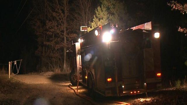 A Potosi fire truck outside the area where a brush fire was burning Tuesday (Credit: KMOV)