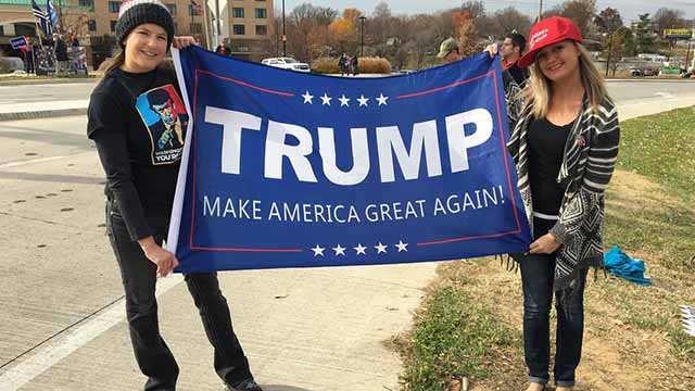 President Trump supporters hold a pro-trump flag in St. Charles, Missouri on November 29, 2017. (KMOV)