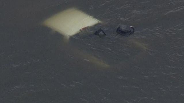 A truck was submerged in the water near Golden Eagle Ferry Road Thursday (Credit: KMOV)