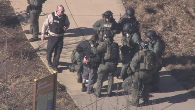 Members of the St. Charles County SWAT team taking a person into custody near Francis Howell High School (Credit: KMOV)