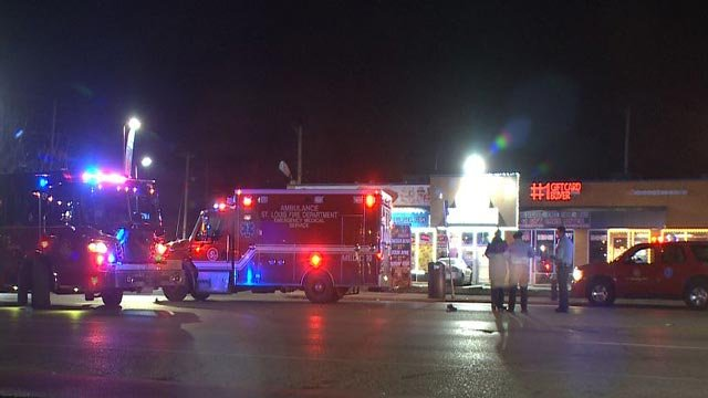 Emergency crews at the intersection of North Grand and Penrose after a hit-and-run Thursday night (Credit: KMOV)