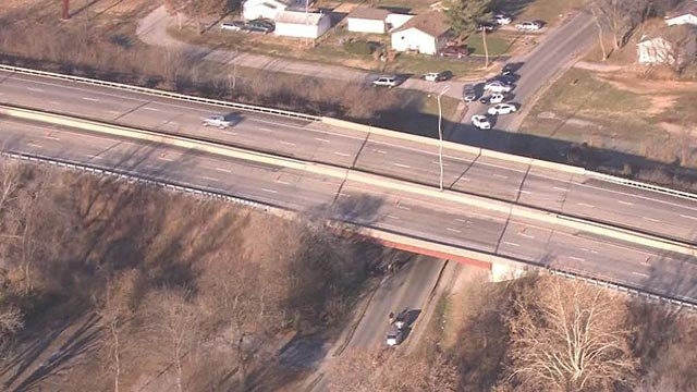 Investigators on Doris Road near Interstate 255 after a man's body was found (Credit: KMOV)