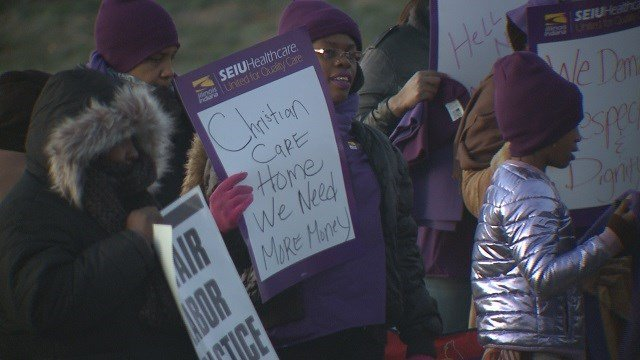 Picketers gathered outside of Christian Care Home Friday morning. (Credit: KMOV)