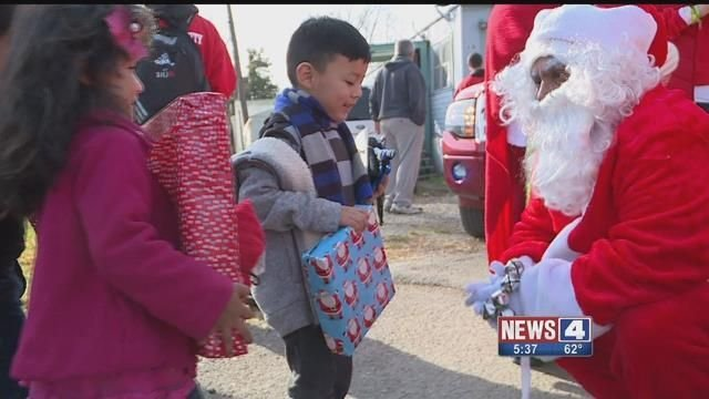 Firefighters brought Christmas cheer to kids in Fairmont City on Sunday. Credit: KMOV