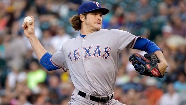 Miles Mikolas pitching for the Texas Rangers in 2014. (AP Photo/Elaine Thompson)