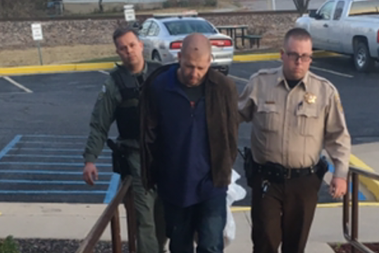 Justin Gillers being walked into Phelps County Sheriff Department (Credit: Phelps Co. Sheriff)