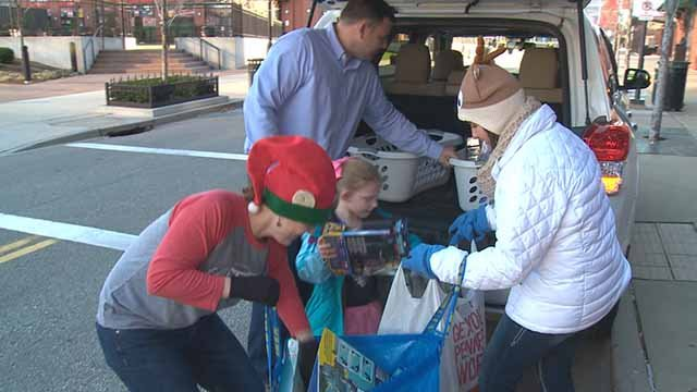 People dropping off gifts at the Cardinals Care Holiday Gift Drive on Dec. 6. Credit: KMOV