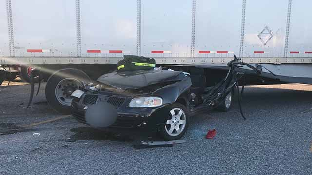 The driver of this car was extricated after it was crushed by a tractor trailer. Credit: KMOV