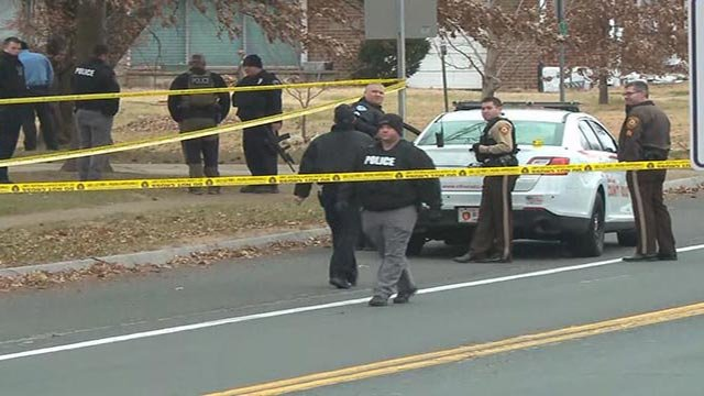 Officers on Bellefontaine Road after two officers were shot (Credit: KMOV)