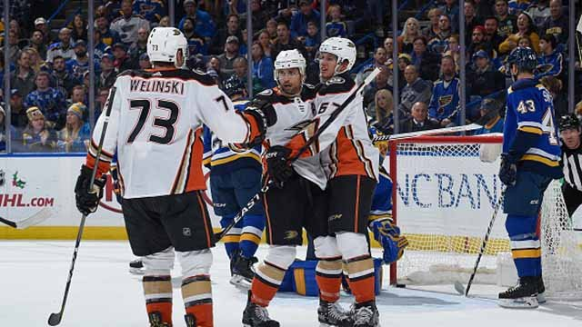 Andrew Cogliano #7 of the Anaheim Ducks is congratulated by teammates after scoring a goal against the St. Louis Blues at Scottrade Center on December 14, 2017 in St. Louis, Missouri. (Photo by Joe Puetz/NHLI via Getty Images)