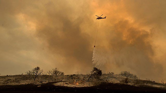 California firefighters continue to battle flames across the state. (Credit: AP)