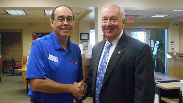 State Rep. Beiser, right, at Banker for a Day event in 2015. (Credit: Office of the Illinois State Representative District 111)