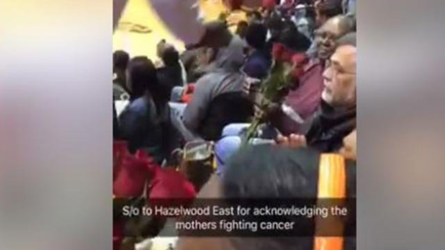 Still image from a video showing Hazelwood East basketball players giving roses to parents battling cancer (Credit: Robert Mcbride / Facebook)