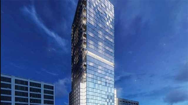 A developer wants to turn a historic building across from Busch Stadium into a 33-story skyscraper. Credit: KMOV