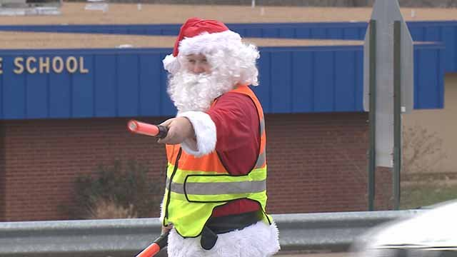 Gibson made a wager with the students. If the student council raised $500 to support Officer O'Connor, who was shot two weeks ago, he would direct traffic in Santa's suit. Credit: KMOV