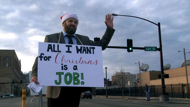 Donald Grooms was handing out resumes at the intersection of Carr Street and North Tucker.  (Credit: KMOV)